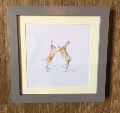 'Boxing Hares' Framed Print by Sam Purcell