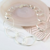 Silver plated matt finish twisted hoop necklace by Peace of Mind