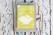 Headlong Hare Yellow Ochre A6 plain notebook by Sam Wilson Studio