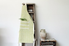Green stripe and leaf print linen apron by Sam Wilson Studio