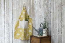 Headlong Hare Yellow Ochre Cotton Apron by Sam Wilson Studio