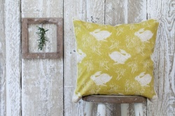 Headlong Hare ochre cotton cushion by Sam Wilson Studio
