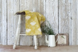 Headlong Hare, ochre cotton tea towel by Sam Wilson Studio