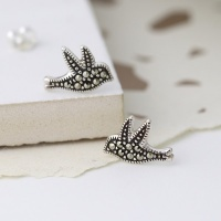 Sterling silver and marcasite flying bird stud earrings by Peace Of Mind