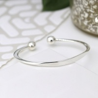 Sterling silver torq bangle with knife edge design by Peace Of Mind