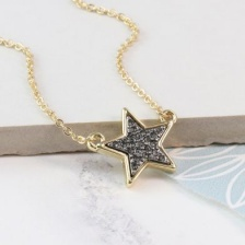 Golden star necklace with black sparkle centre by Peace of Mind