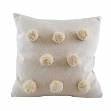 Natural giant pom pom cushion by Raine & Humble