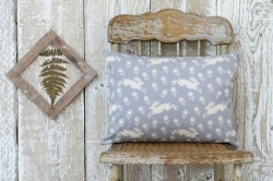 Running Hare grey cotton, rectangle cushion by Sam Wilson Studio
